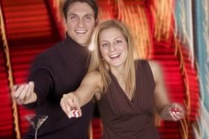 Gambling Couple Handing over Dice